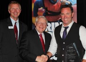 SePRO President Bill Cullpepper and Aquatic Manager Sam Barrick award Aquatechnex Ian Cormican the Applicator of the Year Award